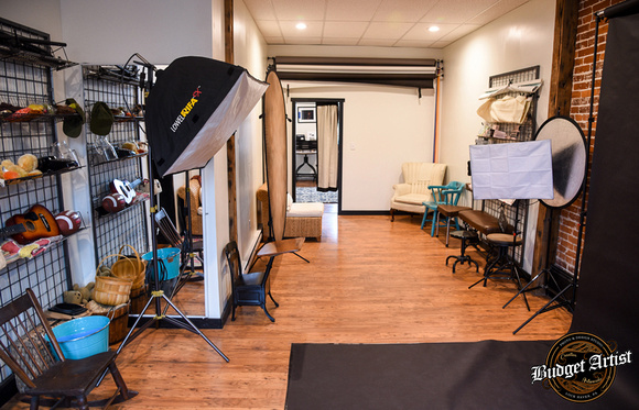 The back half of the studio space features hardwood floors and various backdrops. It's perfect for intimately lit portraits and sports shots.